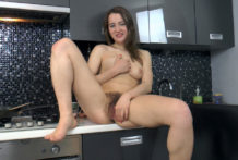 Yana Cey wanks during the time that cooking in her kitchen